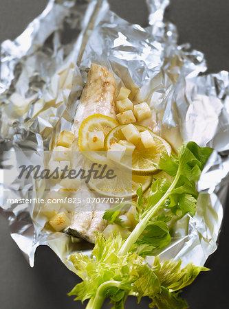 Bass fillet,lemon ,celery and celeriac root cooked in aluminium foil
