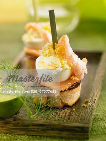 Spanish ham,smoked salmon,shrimp ,egg and mayonnaise crostini
