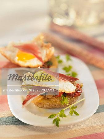 Potato with pesto,fried quail's egg and Serrano ham