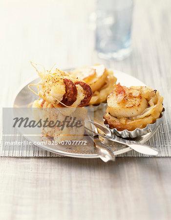 Mini scallop tartlets and monkfish and chorizo appetizer