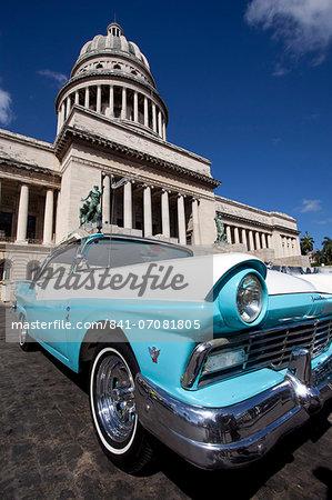 Blue vintage American car parked opposite The Capitolio, Havana Centro, Havana, Cuba, West Indies, Central America