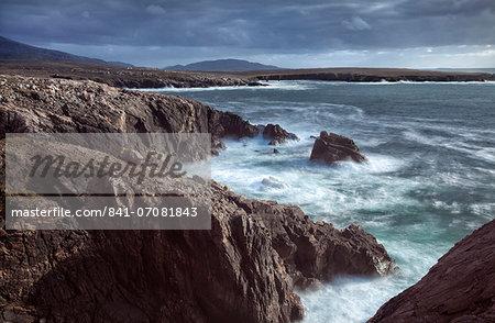 Rugged coastline being pounded by waves on the West coast of Lewis near Mangersta, Isle of Lewis, Outer Hebrides, Scotland, United Kingdom, Europe