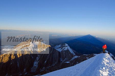 Climber on summit of Mont Blanc, Chamonix, Haute-Savoie, French Alps, France, Europe
