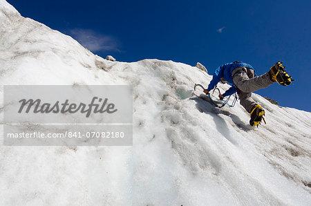 Ice climber at Mer de Glace glacier, Chamonix, Haute-Savoie, French Alps, France, Europe