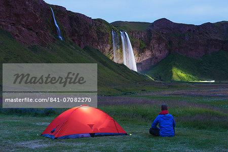 Seljalandsfoss waterfall lit up at night, Southern Region, Iceland, Polar Regions