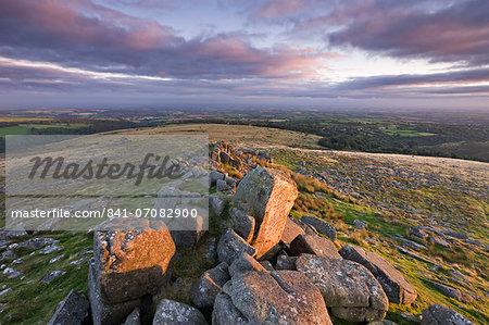 Early morning sunlight lights up the granite rocks of Belstone Tor, Dartmoor National Park, Devon, England, United Kingdom, Europe