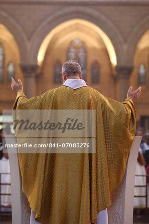 Priest during Eucharist celebration, Paris, France, Europe