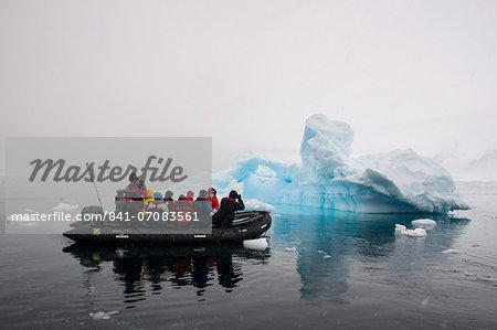 Tourists in a Zodiac crusing through icebergs, Enterprise Island, Antarctica, Polar Regions