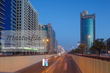 City skyline on Rashid Bin Saeed Al Maktoum Street at dusk, Abu Dhabi, United Arab Emirates, Middle East
