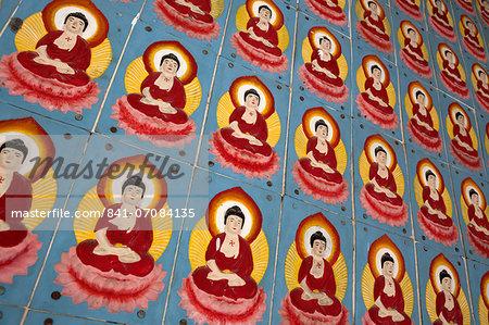 Buddha tiles on walls of Kek Lok Si Temple, Crane Hill, Georgetown, Pulau Penang, Malaysia, Southeast Asia, Asia