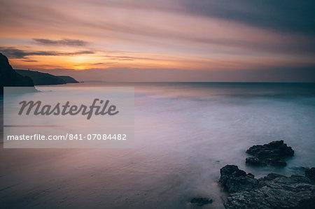Porthtowan beach looking along the Cornish coastline at sunset, Porthtowan, Cornwall, England, United Kingdom, Europe