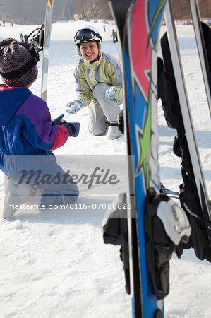 Smiling Family with Ski Gear in Ski Resort