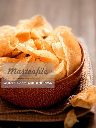 close up of a bowl of potato crisps