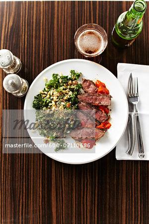 Overhead View of Steak with Vegetables and Beer, Studio Shot
