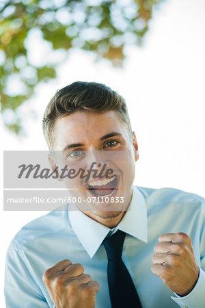 Portrait of Businessman Cheering, Mannheim, Baden-Wurttemberg, Germany