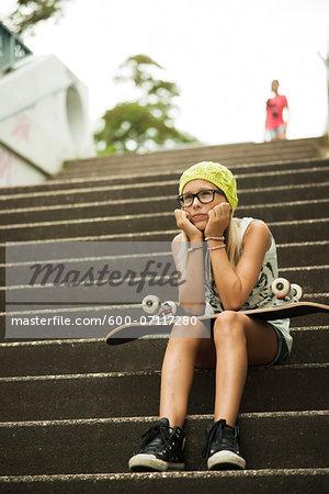 Girl Sitting on Steps with Skateboard, Mannheim, Baden-Wurttemberg, Germany