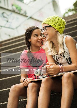 Girls Sitting on Steps with Skateboard, Mannheim, Baden-Wurttemberg, Germany