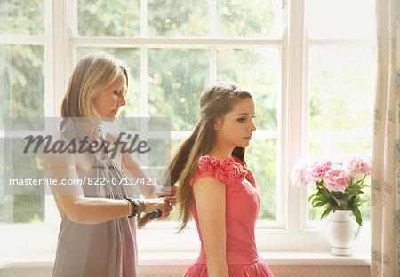 Woman Brushing Teenage Girl's Hair