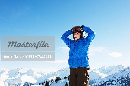 Portrait of boy with hands on head, Les Arcs, Haute-Savoie, France