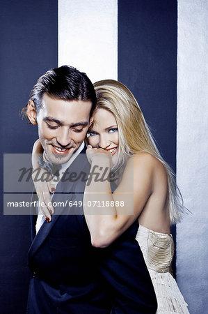 Young couple posing in nightclub