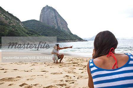 Father and son on beach, Rio de Janeiro, Brazil