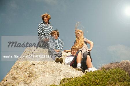 Children sitting on rocks