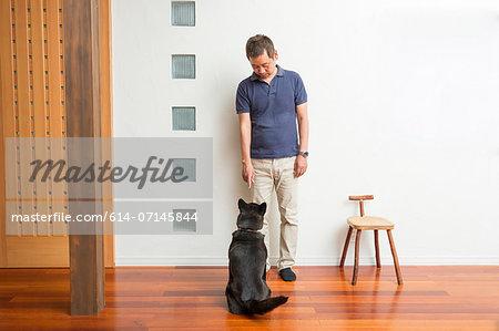 Man training his pet dog
