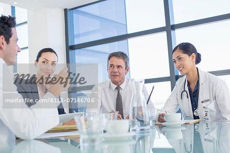 Doctors talking in meeting