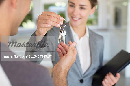 Realtor giving man house keys