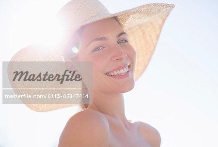 Woman wearing sun hat outdoors