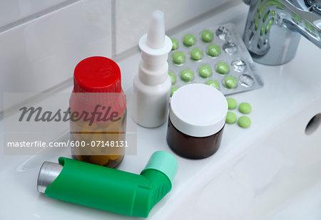 Variety of medications on bathroom sink, studio shot
