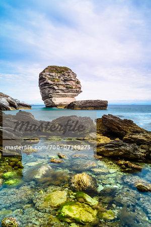 View of the rocky shoreline, cliffs and Grain de Sable Rock, Bonifacio, Corsica, France
