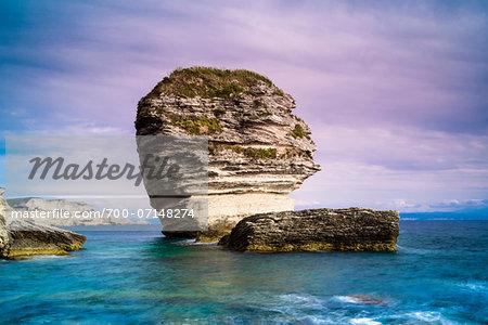 View of the rocky shoreline, white cliffs and Grain de Sable Rock, Bonifacio, Corsica, France