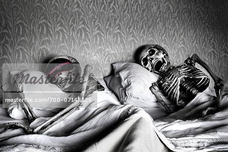 Skeleton Couple Sleeping in Bed