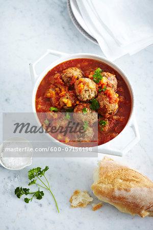 Sweet and Sour Turducken Meatballs in baking dish, studio shot