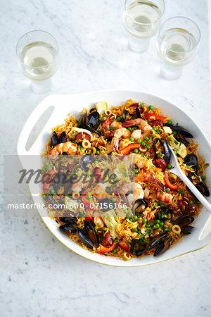 Seafood Paella in casserole dish, studio shot