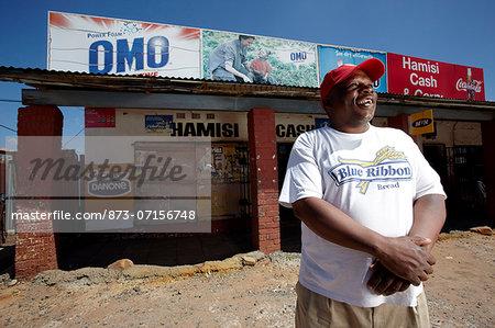 Man standing in front of shop, Soweto, Johannesburg, Gauteng