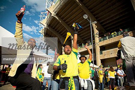 Soccer fans cheering outside a soccer stadium