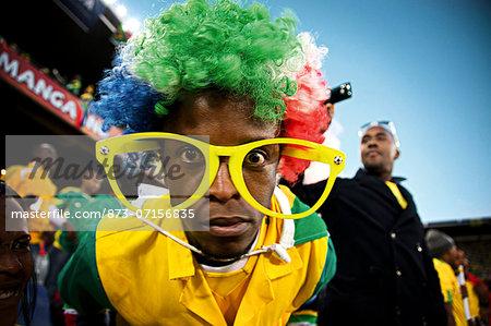 Soccer fans cheering inside a soccer stadium