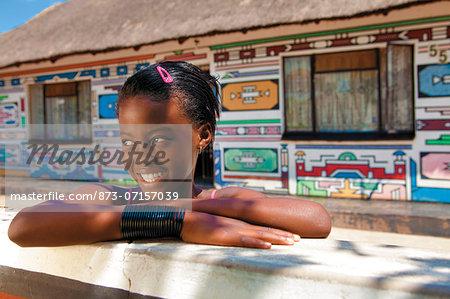 Ndebele houses and young girl