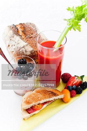 Studio shot of bloody mary, yoghurt and sandwich