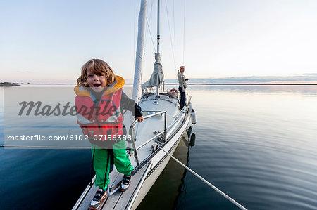 Happy boy on sailing boat
