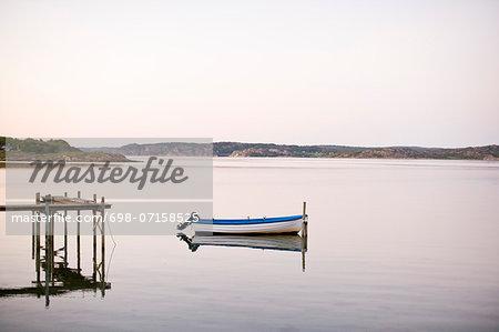 Motorboat moored in lake