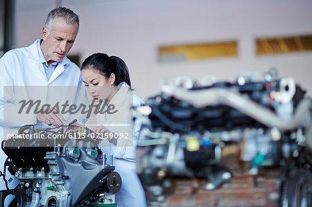 Scientists working on machine