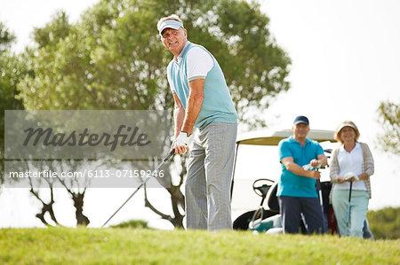 Senior friends playing golf