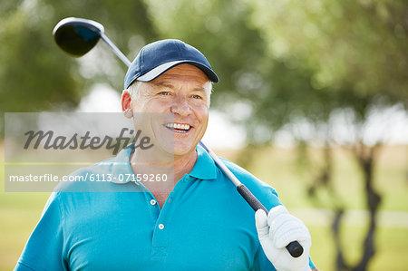 Senior man holding golf club