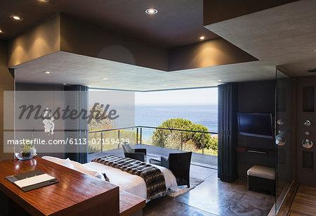 Modern bedroom overlooking ocean
