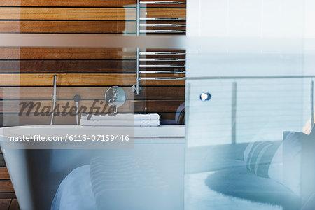 Bathtub and glass door in modern bathroom