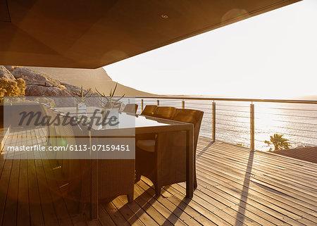 Dining table on luxury patio overlooking ocean