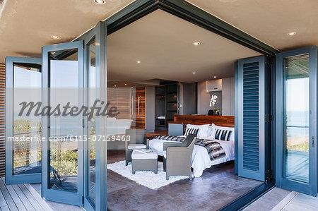 Doors on patio open to modern bedroom